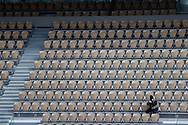 Alone photographer isolated among the empty seats around is dressed as in winter equipped with caps, scarves, jackets, folded up on themselves seized by the cold and wet wind on Philippe Chatrier stadium during the Roland Garros 2020, Grand Slam tennis tournament, on October 5, 2020 at Roland Garros stadium in Paris, France - Photo Stephane Allaman / ProSportsImages / DPPI