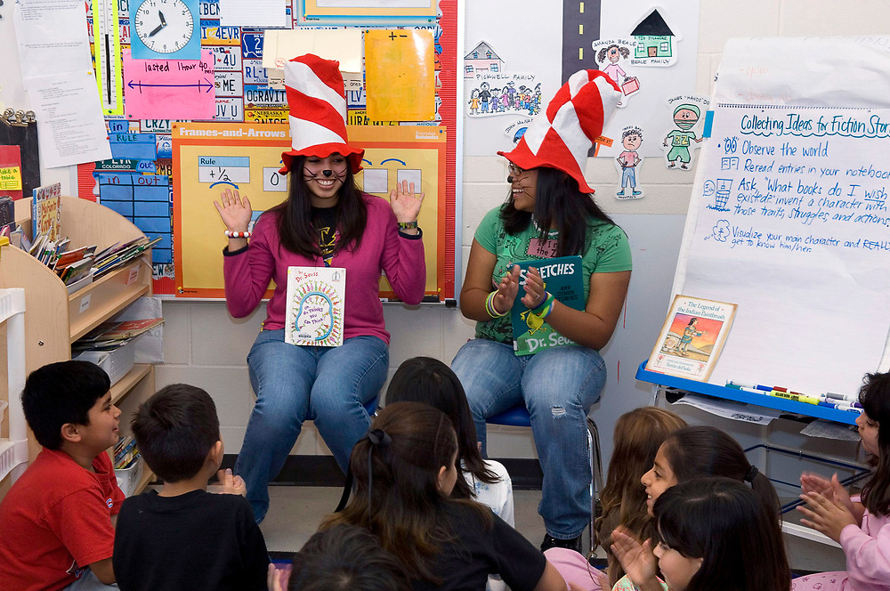 Donna, Texas:  High school seniors read to third graders on Dr. Seuss' birthday at the IDEA Public School, a seven-year old charter school with 1,200 mostly Hispanic students in south Texas.  March 1, 2007  ©Bob Daemmrich/
