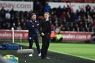 Swansea city manager Garry Monk ® and Leicester city manager Nigel Pearson look on.Barclays Premier league match, Swansea city v Leicester city at the Liberty stadium in Swansea, South Wales on Saturday 25th October 2014<br /> pic by Andrew Orchard, Andrew Orchard sports photography.