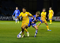 Callum Robinson holds off the challenge from Gillingham's Jake Hessenthaler<br /> <br /> Photographer Ashley Western/CameraSport<br /> <br /> Football - The Football League Sky Bet League One - Gillingham v Preston North End - Tuesday 21st October 2014 - MEMS Priestfield Stadium - Gillingham<br /> <br /> © CameraSport - 43 Linden Ave. Countesthorpe. Leicester. England. LE8 5PG - Tel: +44 (0) 116 277 4147 - admin@camerasport.com - www.camerasport.com