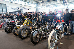 A flash comes from Russian photographer Paulina Krasnova's camera at the MBE award finals at Motor Bike Expo (MBE) bike show. Verona, Italy. Friday, January 17, 2020. Photography ©2020 Michael Lichter.