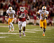 Nov 12, 2011; Fayetteville, AR, USA;  Arkansas Razorback running back Dennis Johnson (33) runs the ball for a touchdown as Tennessee Volunteers defensive backs Rod Wilks (22) and A.J. Johnson (45) pursue during the first half at Donald W. Reynolds Razorback Stadium. Arkansas defeated Tennessee 49-7. Mandatory Credit: Beth Hall-US PRESSWIRE