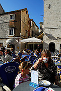 Mother and daughter (5 years old) in open-air cafe, John Paul II Square (Trg Ivana Pavla II), Trogir, Croatia