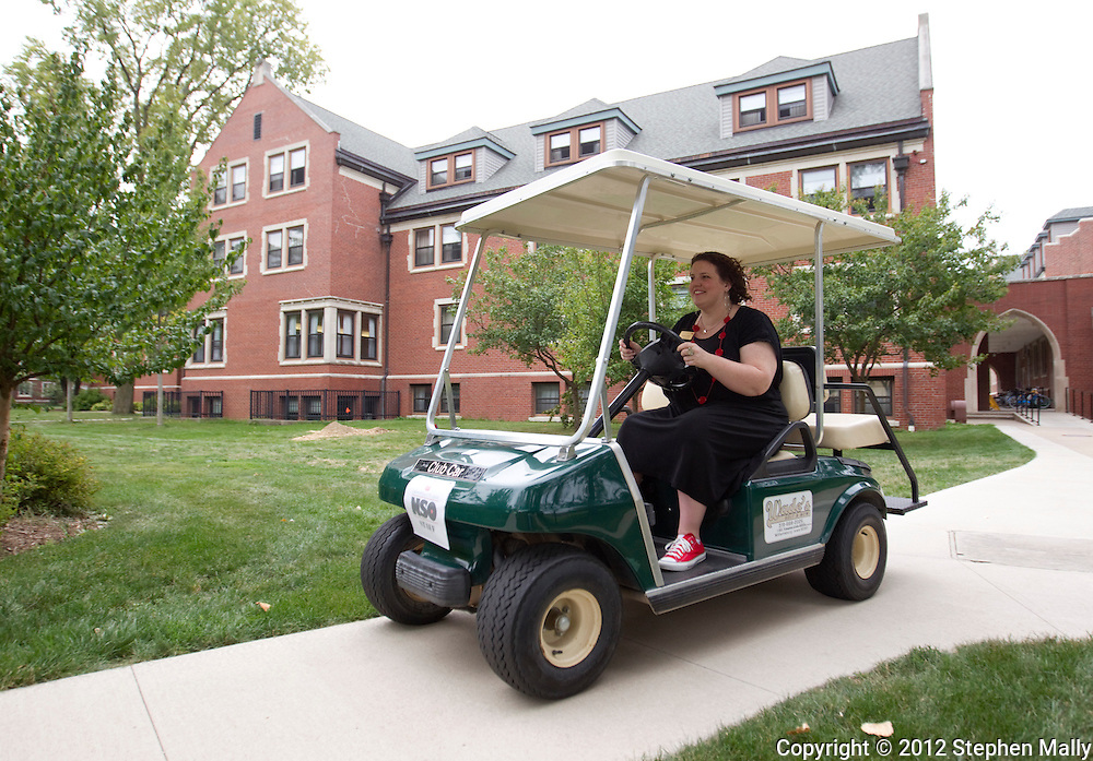 Andrea Conner, Assistant Dean of Students and Director of Residence Life and Orientation, drives to her next location on a golf cart at Grinnell College in Grinnell, Iowa on Saturday, August 25, 2012.