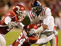 FAYETTEVILLE, AR - OCTOBER 25:   Shay Hodge #3 of the Ole Miss Rebels is tackled after catching a pass by Isaac Madison #24 of the Arkansas Razorbacks at Donald W. Reynolds Stadium on October 25, 2008 in Fayetteville, Arkansas.  The Rebels defeated the Razorbacks 23 to 21.  (Photo by Wesley Hitt/Getty Images) *** Local Caption *** Shay HodgeUniversity of Arkansas Razorback Men's and Women's athletes action photos during the 2008-2009 season in Fayetteville, Arkansas....©Wesley Hitt.All Rights Reserved.501-258-0920.