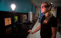 August 21, 2017 - Boynton Beach, Florida, U.S. - Milena Graver, 7th grader at Christa McAuliffe Middle School tests out her eclipse glasses before walking outside to the the partial eclipse in Boynton Beach, Florida on August 21, 2017. (Credit Image: © Allen Eyestone/The Palm Beach Post via ZUMA Wire)
