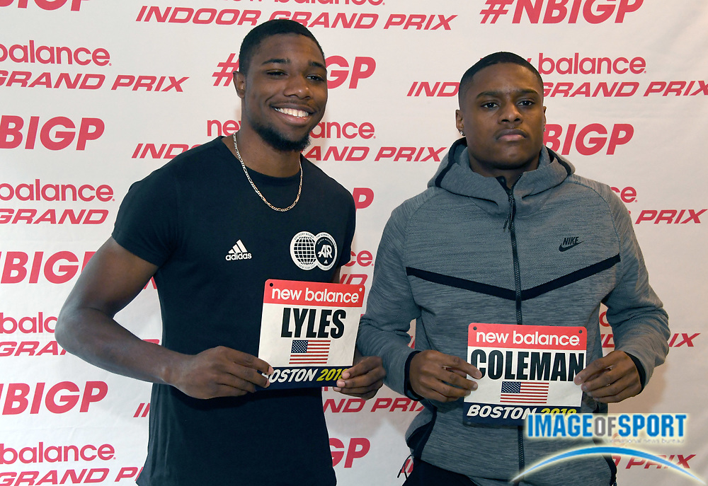 Noah Lyles (left) and Christian Coleman poses with race bibs during a  press conference prior to the New Balance Indoor Grand Prix in Boston on Friday, Feb. 9, 2018.