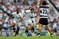 Elliot Daly (England looks to put in a grubber kick behind the Barbarians defence - Photo mandatory by-line: Patrick Khachfe/JMP - Tel: Mobile: 07966 386802 01/06/2014 - SPORT - RUGBY UNION - Twickenham Stadium, London - England XV v Barbarians - International Friendly.