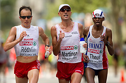 Viktor Roethlin of Switzerland, Jose Manuel Martinez of Spain and James Theuri of France compete in the Mens Marathon during day six of the 20th European Athletics Championships at the roads of city Barcelona on August 1, 2010 in Barcelona, Spain. (Photo by Vid Ponikvar / Sportida)