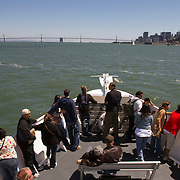 Visitors to Alcatraz Island make their way across the water on a ferry to the island where the prison is located.