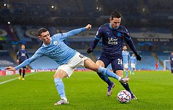 MANCHESTER, ENGLAND - Wednesday, December 9, 2020: Manchester City's Phil Foden (L) and Olympique de Marseille's Florian Thauvin during the UEFA Champions League Group C match between Manchester City FC and Olympique de Marseille at the City of Manchester Stadium. Manchester City won 3-0. (Pic by David Rawcliffe/Propaganda)