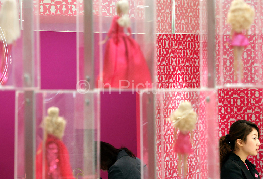 Employees stand in attendance during the Media Sneak Preview of the new Barbie Shanghai flagship store in Shanghai, China on 20 February 2009.  The Barbie store has become a hit in Shanghai as a place where doting mothers take their daughters, often the only child in the family, for a girls' day out.