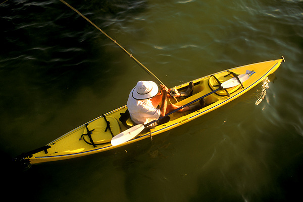 Stock photo of an aerial view of a man fishing from his kayak