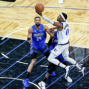 ORLANDO, FL - MARCH 01: Josh Richardson #0 of the Dallas Mavericks drives past Khem Birch #24 of the Orlando Magic during the second half at Amway Center on March 1, 2021 in Orlando, Florida. NOTE TO USER: User expressly acknowledges and agrees that, by downloading and or using this photograph, User is consenting to the terms and conditions of the Getty Images License Agreement. (Photo by Alex Menendez/Getty Images)*** Local Caption *** Josh Richardson; Khem Birch