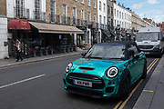 A shiny metallic turquoise Mini car on the 25th September in London in the United Kingdom.