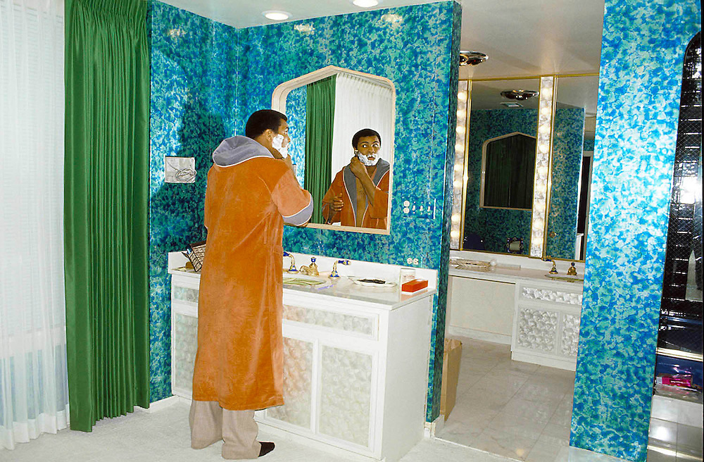 World  heavyweight champion boxer Muhammed Ali, known as the 'Greatest' seen in his bathroom at his Chicago home, USA in 1977. Also known as Cassius Clay. Photographed by Terry Fincher