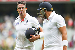 © Licensed to London News Pictures. 26/12/2013. Kevin Pietersen and Tim Brenan walk off at the conclusion of the days play  during the Ashes Boxing Day Test Match between Australia Vs England at the MCG on 26 December, 2013 in Melbourne, Australia. Photo credit : Asanka Brendon Ratnayake/LNP