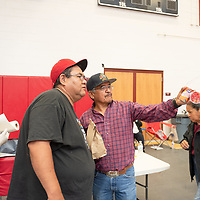 Bill Martinez, 45, left, of Crownpoint and Johnny Devore, 65, right, of Casamero Lake coordinate meals fo the seniors during the elder fashion show. The event was held in the Wellness Center in Crownpoint on May 07.