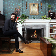 Matt Morris, also known as Teo Bishop, left the Episcopalian Church to become a neo-Pagan, but has recently returned to Christianity and is reconciling the two worlds. He is photographed in his Portland, Ore., home.