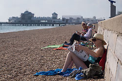 © Licensed to London News Pictures. 21/09/2016. Portsmouth, UK.  A woman reading the DAILY MAIL on the beach whilst enjoying the warm and sunny afternoon in Southsea today, 21st September 2016. Photo credit: Rob Arnold/LNP