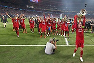 CHAMPIONS Liverpool players and staff celebrate and Liverpool midfielder Jordan Henderson (14) lifts the trophy after Liverpool win the UEFA Champions League Final match between Tottenham Hotspur and Liverpool at Wanda Metropolitano Stadium, Madrid, Spain on 1 June 2019.