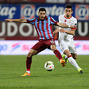 Trabzonspor's Ozer Hurmaci (L) during their Turkish SuperLeague Derby match Trabzonspor between Galatasaray at the Avni Aker Stadium at Trabzon Turkey on Sunday, 19 April 2015. Photo by TVPN/TURKPIX