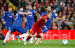 Liverpool's Xherdan Shaqir battles for the ball with Chelsea's Cesc Fabregas (right) during the Carabao Cup, Third Round match at Anfield, Liverpool.