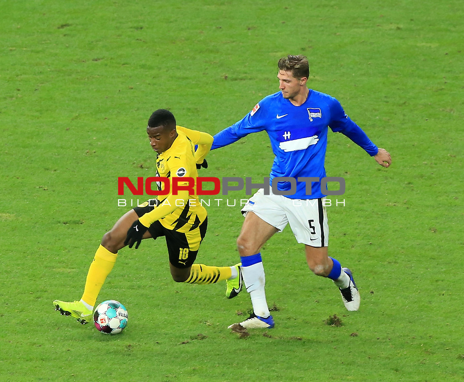21.11.2020, OLympiastadion, Berlin, GER, DFL, 1.FBL, Hertha BSC VS. Borussia Dortmund, <br /> DFL  regulations prohibit any use of photographs as image sequences and/or quasi-video<br /> im Bild Niklas Stark (Hertha BSC Berlin #5), <br /> Youssoufs Moukoko (Borussia Dortmund #18)<br /> <br />       <br /> Foto © nordphoto / Engler