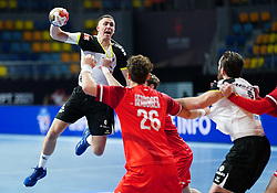 14.01.2021, 6th of October Sports Hall, Gizeh, EGY, IHF WM 2021, Österreich vs Schweiz, Herren, Gruppe E, im Bild Romdhane Mehdi Ben, Lukas Herburger, // during the IHF men's World Championship group E match between Austria and Switzerland at the 6th of October Sports Hall in Gizeh, Egypt on 2021/01/14. EXPA Pictures © 2020, PhotoCredit: EXPA/ Diener/Eva Manhart<br /> <br /> *****ATTENTION - OUT of AUT and SUI*****
