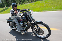 17-year old twin Matthew Knight on his 2004 Softail on the Cycle Source ride down Vanocker Canyon back from Nemo to the Iron Horst Saloon during the Sturgis Black Hills Motorcycle Rally. SD, USA. Wednesday, August 7, 2019. Photography ©2019 Michael Lichter.