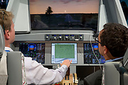 A visitor to the BAE Systems exhibition hall, is shown a flight simulator that demonstrates Active Control control joysticks at the Farnborough Airshow, on 18th July 2018, in Farnborough, England.