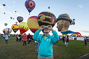 AARP's Bruce Breslau takes a panoramic photo at the AARP Block Party at the Albuquerque International Balloon Fiesta in Albuquerque New Mexico USA on Oct. 8th, 2018.