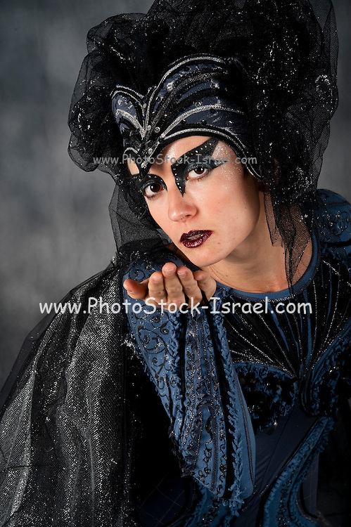 Bat Woman - female actress in her 20s with make up and a bat costume close up of head and face
