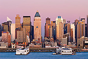 Skyline view of New York City at dusk with skyscrapers of Midtown Manhattan, including, from left, the Citicorp Center, Worldwide Plaza and Morgan Stanely Headquarters.