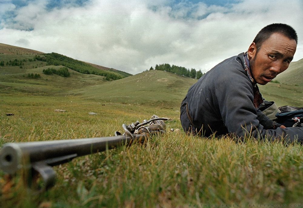 A marmot and wolf hunter takes a break while hunting in Western Mongolia. Husbandry is the main livelihood in Mongolia, and unfortunately many sheep get killed by wolves everyyear.