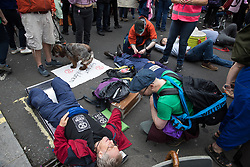 London, UK. 23rd August, 2021. Environmental activists from Extinction Rebellion use lock-ons to block a road in the Covent Garden area during the first day of Impossible Rebellion protests. Extinction Rebellion are calling on the UK government to cease all new fossil fuel investment with immediate effect. Credit: Mark Kerrison/Alamy Live News