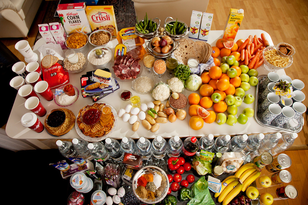 A portion of the table of a week's food of the Qureshi family of Lorenskog, Norway, an Oslo suburb. Pritpal Qureshi, 49, her husband Nasrullah, 51, and their daughter Nabeela, 23. Food Expenditure for one week: 2,002.48 Norwegian Kroner; $343.48 USD. Model-Released.