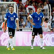 Estonia's Taavi RAHN (R) with Martin VUNK during their FIFA World Cup 2014 qualifying soccer match Turkey betwen Estonia at Sukru Saracoglu stadium in Istanbul September 11, 2012. Photo by TURKPIX