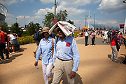 London, UK. Thursday 9th August 2012. London 2012 Olympic Games Park in Stratford. A visitor to the park uses a newspaper to protect his head from the strong sun.