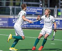 AMSTELVEEN - Guus Jansen (Rotterdam) heeft gescoord    tijdens de hoofdklasse competitie-wedstrijd  heren ,rechts Menno Boeren (Rotterdam)  PINOKE-ROTTERDAM (2-2)  .COPYRIGHT  KOEN SUYK