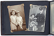 photo album page with studio vintage portrait images from the 1940s