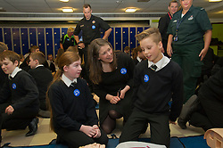 Pictured: Chiana Cherry (aged 12), Aileen Campbell and Aaron Moretta (aged 12)<br /> Minister for Public Health Aileen Campbell joined P7 and S1 students at Beeslack High School in Penicuik for CPR training session attended by representatives from NHS, Police, fire and ambulance services.<br /> <br /> <br /> Ger Harley | EEm 24 November 2016