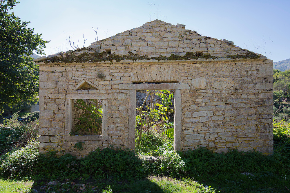 Trees growing inside derelict house ruins in ancient mountain village of Old Perithia - Palea Peritheia - Corfu, Greece