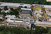 Nederland, Noord-Brabant, Gemeente , 08-07-2010; gevangeniscomplex Vught, officieel Penitentiaire Inrichting Vught. Huisvest onder andere Nieuw Vosseveld (jeugdgevangenis), een TBS afdeling (met long-stay afdeling) en Extra Beveiligde Inrichting (EBI)..Prison complex Vught, officially Vught  Penitentiary Institution. Includes New Vosseveld (juvenile prison), a long-stay unit and a maximum-security prison (EBI)..luchtfoto (toeslag), aerial photo (additional fee required).foto/photo Siebe Swart