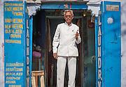 Man at laundry door (India)