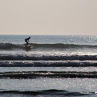 Europe, United Kingdom, Wales. Surfer at Newgale Beach in Pembrokeshire.