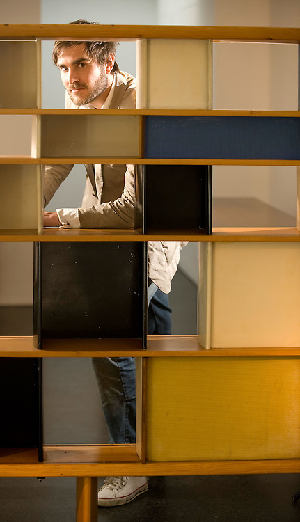 Picture by Daniel Hambury..26/05/09..British art dealer, Oscar Humphries pictured with a bookcase called 'Mexique' by Charlotte Perriand and Jean Prouve in in Mayfair gallery 'Sebastian + Barquet in London..