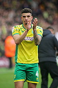 Norwich City midfielder Ben Godfrey (4) claps the fans after the EFL Sky Bet Championship match between Norwich City and Queens Park Rangers at Carrow Road, Norwich, England on 6 April 2019.