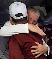 Joe Caley of Tallmadge, embraces former Viet Cong soldier Tam Tien after learning Tien received a Visa to travel to the United States, after many appeals.  Tien was invited to speak at the Summit on Peace and War at Case Western University in late October, 2010.  Saigon, Vietnam.   (Laura Fong Torchia / Special to the Beacon Journal)