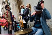 PARIS, FRANCE – SEPTEMBER 24, 2012: Blues-rock guitarist  and street performer René Miller busks among pedestrians.